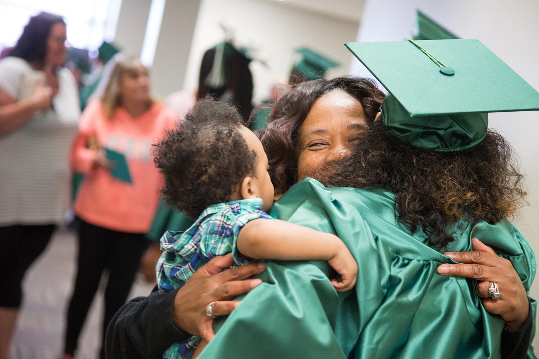 mother daughter son adult high school graduation